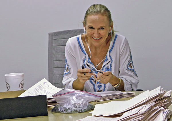Janie Condon at work in conference room (File photo)
