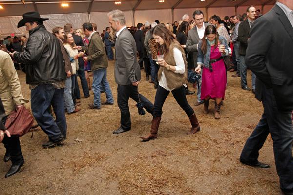 Zac Crain and Cristina Daglas walking through the mud
