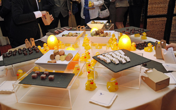 Table of sweet to-go and rubber duckies