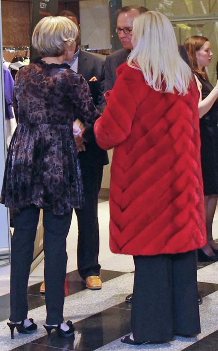 Jennifer Houser's red coat against Stanley Korshak's black-and-white floor