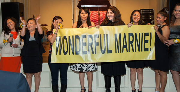 Vickery Meadow Learning Center students with banner*