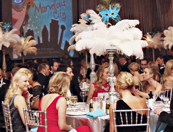 Tables topped with feathers and masks