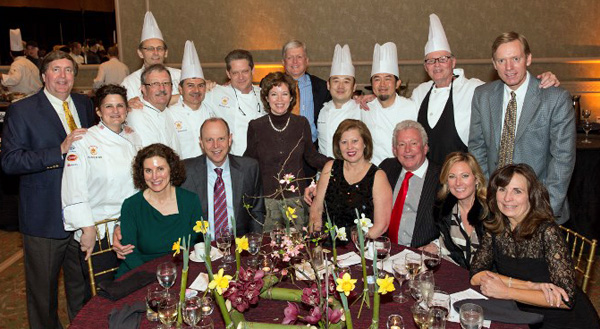 From the left (front row): Melissa and Mark Fuqua, Annie and Randy Click, Liz Pitcher and Linda Kerner; middle row: David Hopson, Chef Michele Brown, Chef Andre Bedouret, Chef David Sokol, Chef Gianni Santin, Chef Michael Scott, Mary Louis Hopson, Andy Kener, Chef Yutaka Yamato, Chef Hiroshi Kimoto, Chef Denny Mclain and Eric Pitcher*