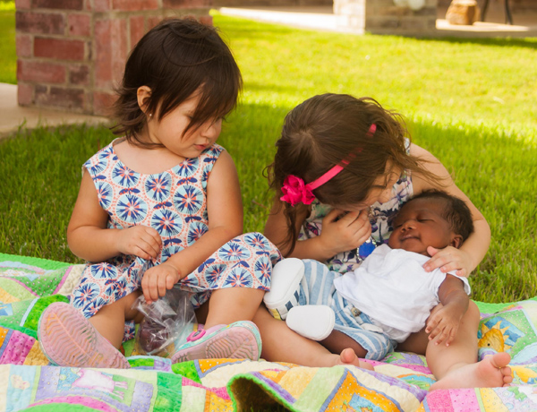 Baby Josiah with sisters*