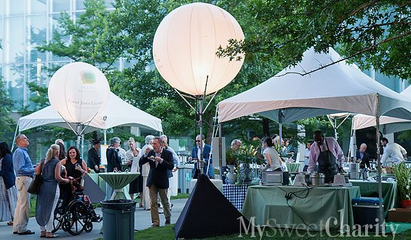 TACA Lexus Party On The Green Felt Right At Home In Its New Sammons Park Setting With Performers, Ice Carvings And Chefs Galore