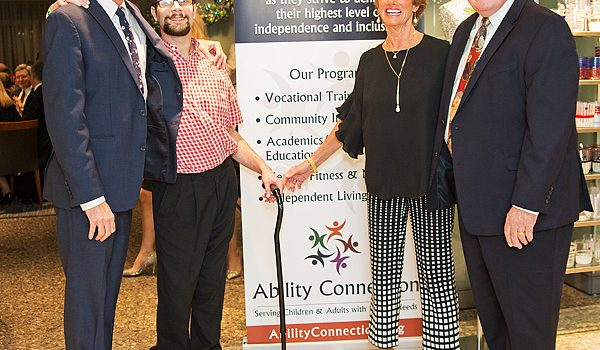 Ability Connection's 10th Annual Vine And Dine Delighted Guests With Fine Cuisine, Success Stories And A Paddle Battle In The Live Auction